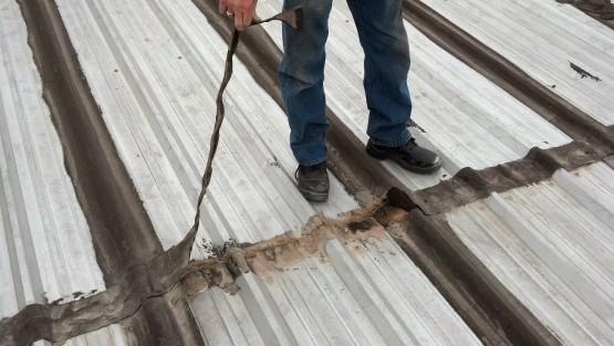 Deteriorated seams on metal roof.